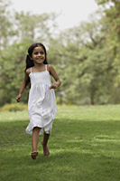 Little girl running in park - Vivek Sharma