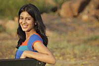 Teen girl on park bench - Vivek Sharma