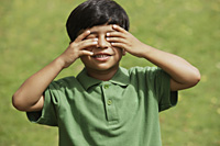 Little boy hiding his eyes - Vivek Sharma