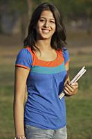Teen girl with books - Vivek Sharma