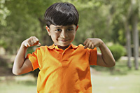 little boy flexing muscles - Vivek Sharma