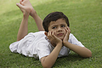 Little boy relaxing in park - Vivek Sharma