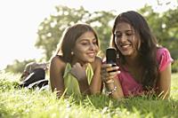 Teen girls reading text messages - Vivek Sharma