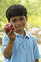 little boy with red apple - Vivek Sharma