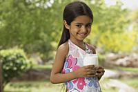 little girl with glass of milk - Vivek Sharma