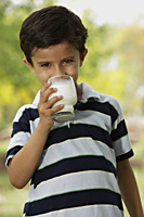 boy drinking glass of milk - Vivek Sharma