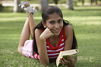 Teen girl with book in the park - Vivek Sharma
