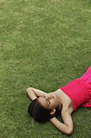 little girl in pink dress sleeping in park - Vivek Sharma