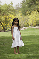 Little girl standing in park - Vivek Sharma