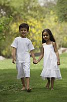 two children holding hands - Vivek Sharma
