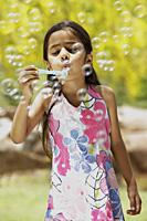 little girl blowing bubbles - Vivek Sharma
