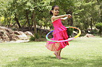 little girl playing with hula hoop - Vivek Sharma