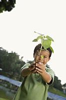 Boy holding plant and soil - Yukmin