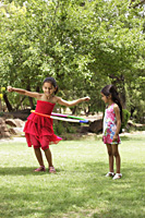 two little girls playing with hula hoop - Vivek Sharma