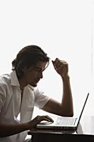 man at laptop - Alex Mares-Manton