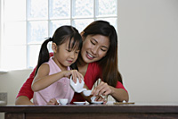 Mother and daughter having tea party - Yukmin