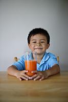 Little boy holding glass of juice - Yukmin