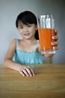 Girl holding glass of juice - Yukmin