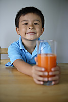 Little boy with glass of juice - Yukmin