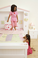 Little girls at play in their bedroom - Alex Mares-Manton