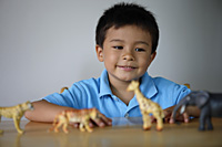 Little boy playing with plastic animals - Yukmin
