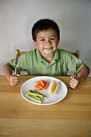 Little boy with plate of vegetables - Yukmin