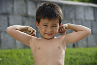 Boy flexing his muscles - Yukmin