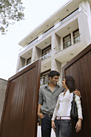 Young couple in front of home - Alex Mares-Manton