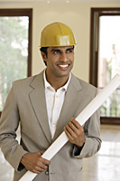 portrait of contractor with blueprints - Alex Mares-Manton