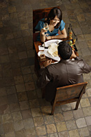 couple enjoying meal and drinks - Alex Mares-Manton