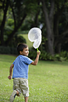 boy chasing butterflies with net - Yukmin