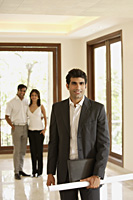 architect with blueprints, young couple in empty home - Alex Mares-Manton