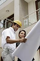 contractors with blueprints - Alex Mares-Manton