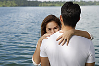 Couple embracing near lake - Yukmin