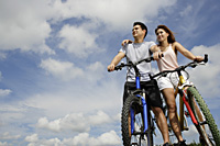 Couple on bicycles - Yukmin