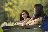 Two teen girls on park bench - Alex Mares-Manton