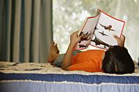 boy reading on bed - Alex Mares-Manton