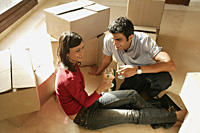 young couple in new home - Alex Mares-Manton