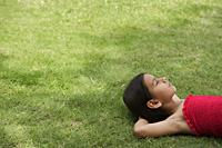 girl lying on back in grass - Alex Mares-Manton