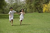 kids running in park, holding hands - Alex Mares-Manton
