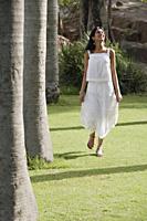 teen girl walking on grass in park - Alex Mares-Manton