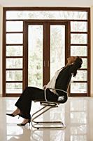 woman in empty office or home - Alex Mares-Manton