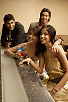 young adults at a bar - Alex Mares-Manton
