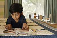 little boy reading book - Alex Mares-Manton