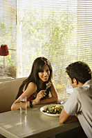 couple sharing salad - Alex Mares-Manton