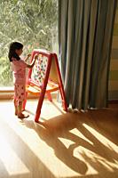 little girl at easel - Alex Mares-Manton