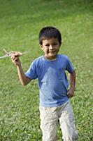 boy holding toy airplane - Yukmin