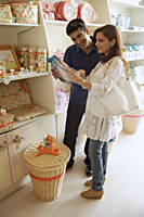 Couple shopping in baby store - Alex Mares-Manton