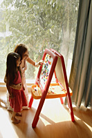 mother and daughter at easel - Alex Mares-Manton