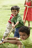 kids playing tug-o-war - Alex Mares-Manton